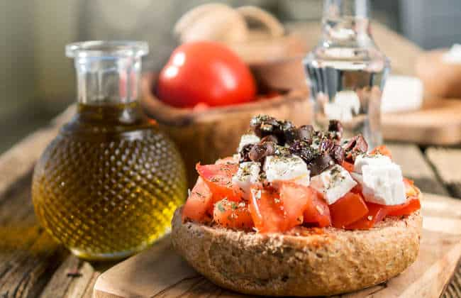 Traditional Cretan Ntakos / Dakos recipe (Rusks with tomatoes and feta cheese)