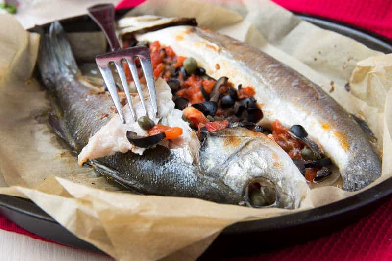 Mediterranean Sea Bass Recipe Stuffed with Tomatoes, Lemons and Olives