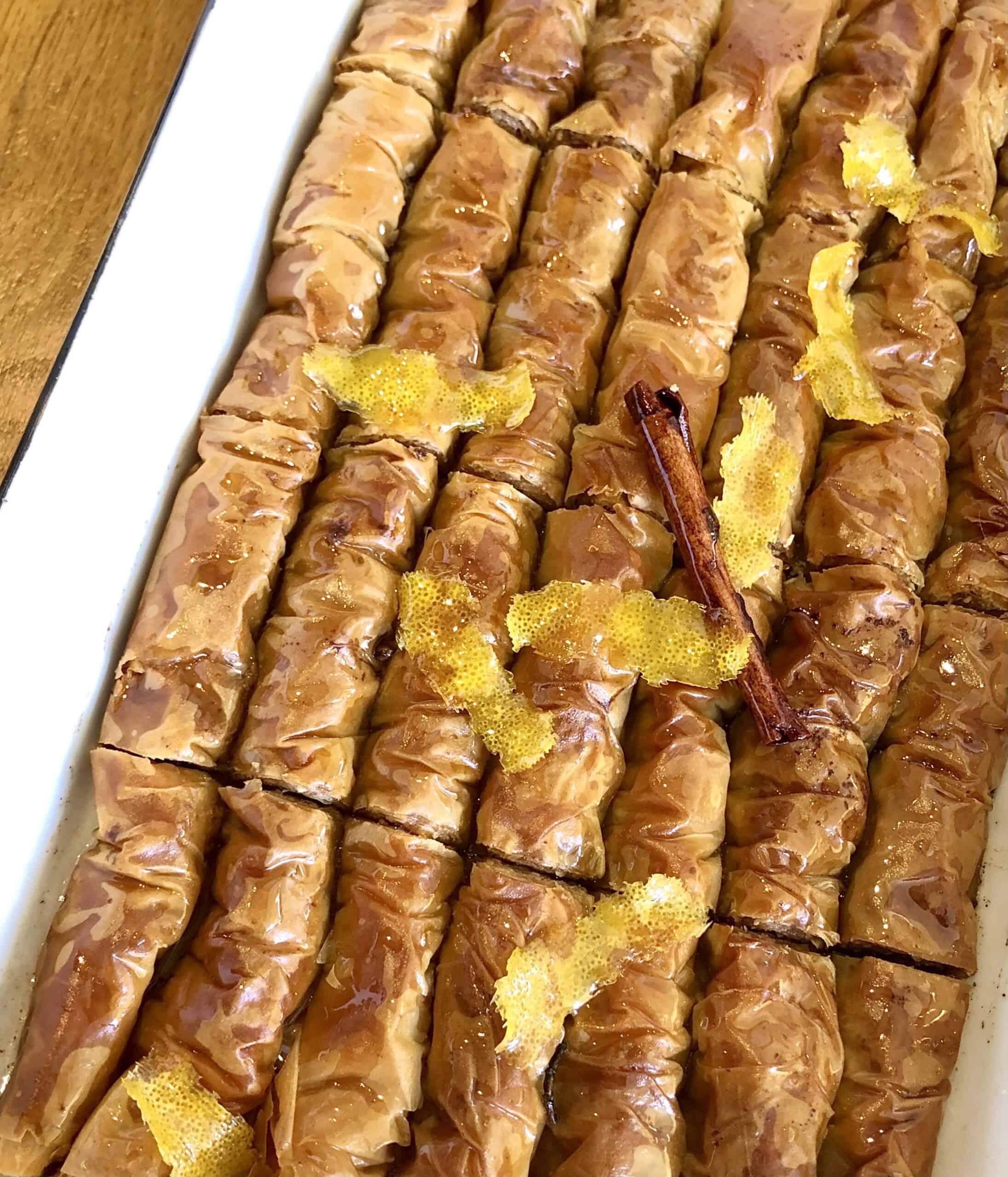 Greek baklava rolls (Saragli) in a baking dish